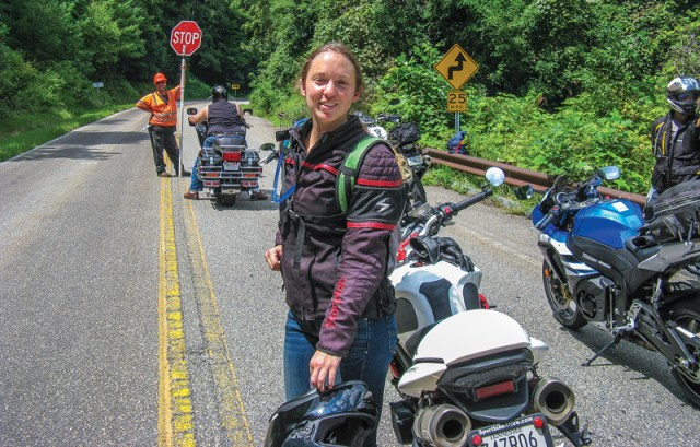 A brief delay due to Skyway resurfacing. Those in cars: windows up and AC on. Those on bikes: making new friends! Our new friend Kyla from Michigan is touring alone on a rented bike. Way to go, Kyla!