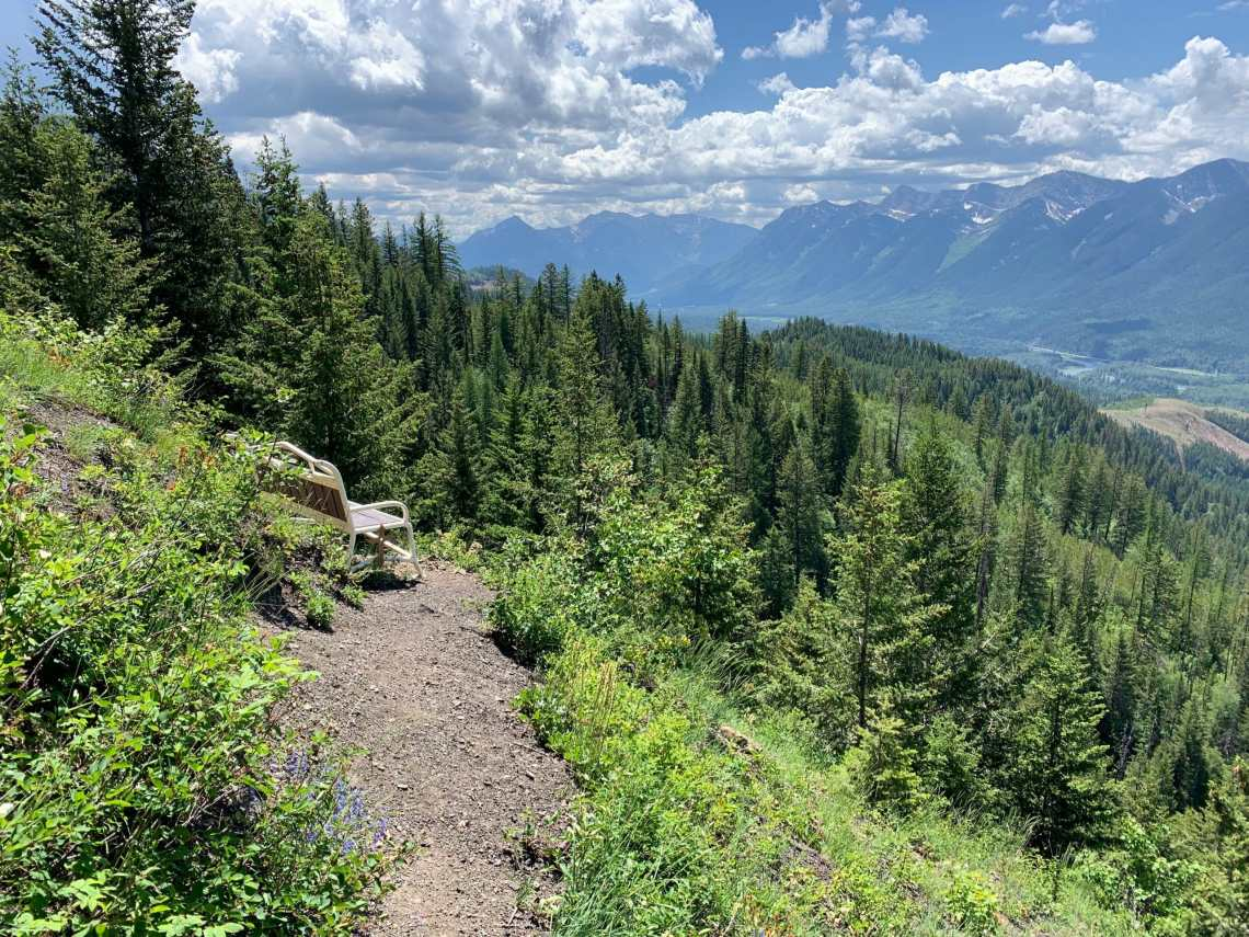 a bench with a view on the Castle Rocks trail in Fernie, BC