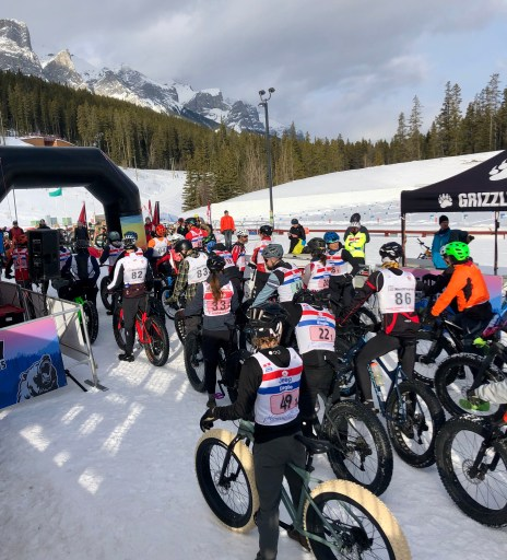 racers line up at the start of a fat bike race