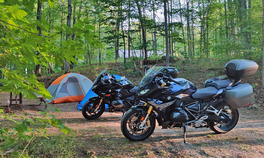 Two motorcycles with a tent