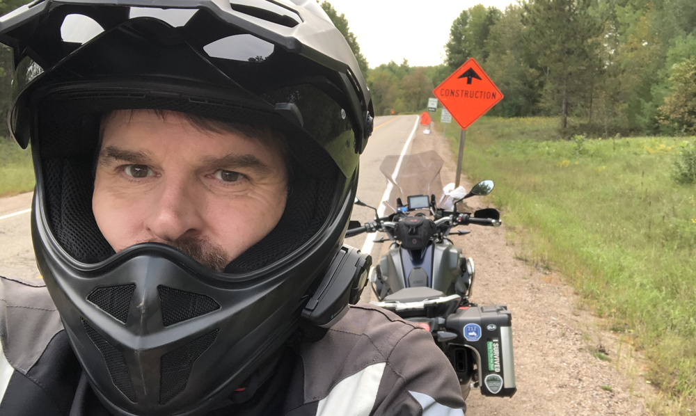 Man with in helmet and motorcycle