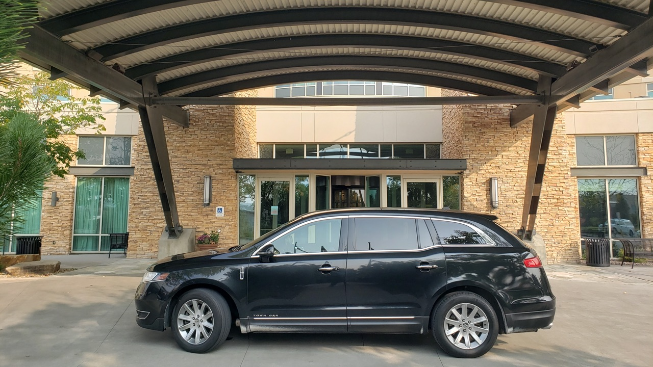 Black sedan by the entrance of Renaissance Hotel in Broomfield Colorado