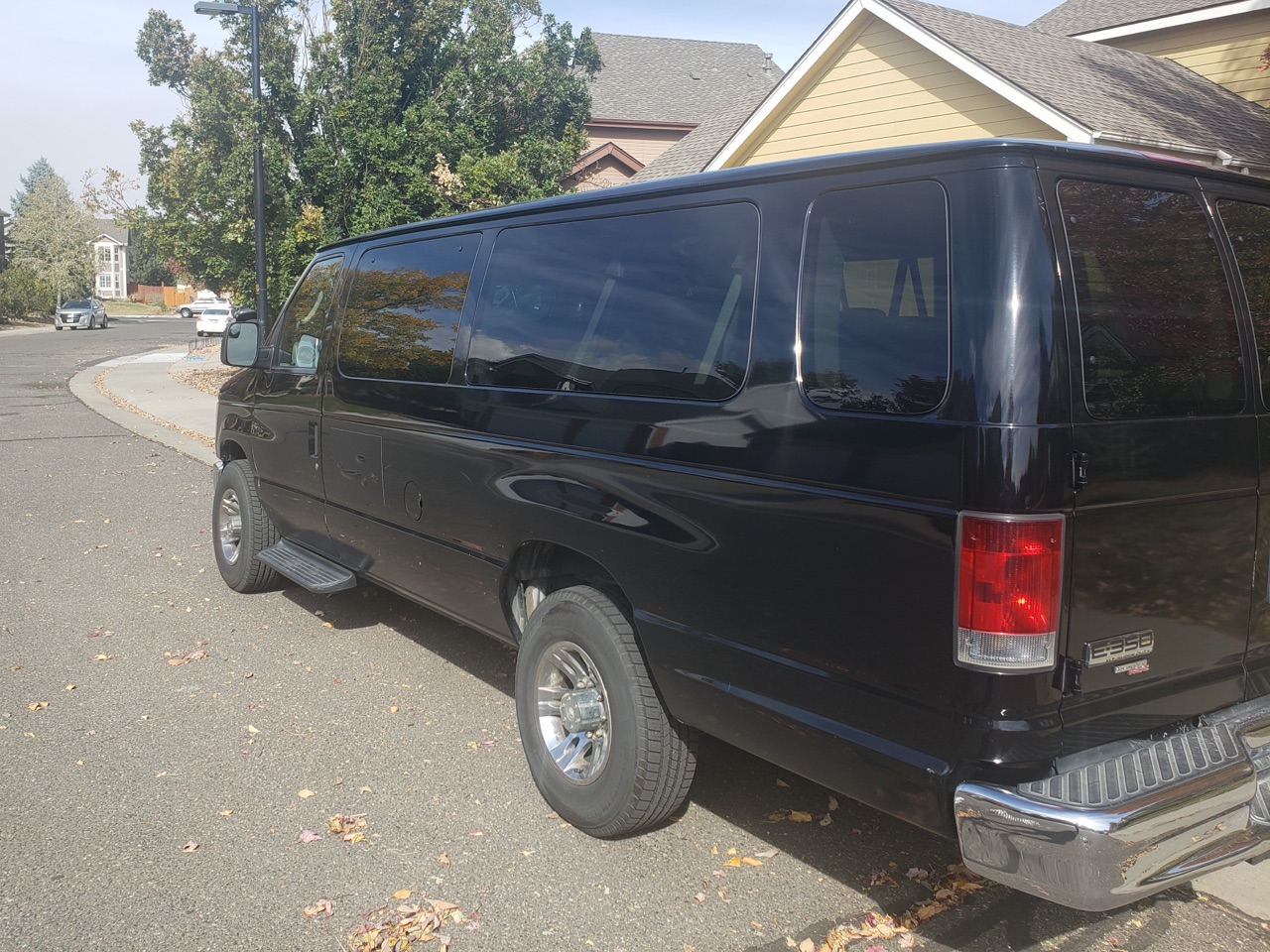 Black VAN at Broomfield CO, airport shuttle waiting for customers at Broomfield Colorado