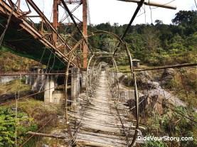 The new steel bridge being built alongside the old footbridge