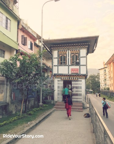 Pedestrian exit to Jaigaon, India on the left and Phuentsholing, Bhutan on the right side of picture.