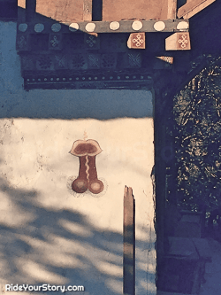 Phallic with a oral depiction painting next to entrance