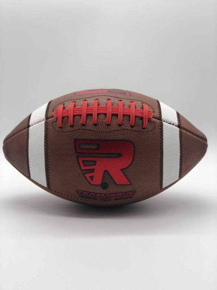 Leather american game ball with red R logo and red lace in photobooth