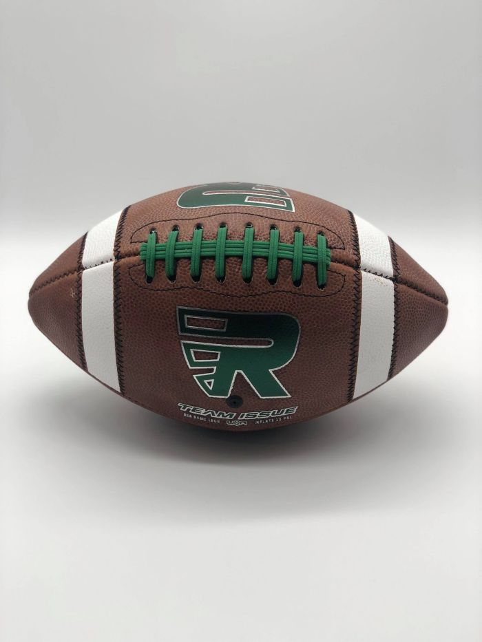 Leather american game ball with green R logo in photobooth