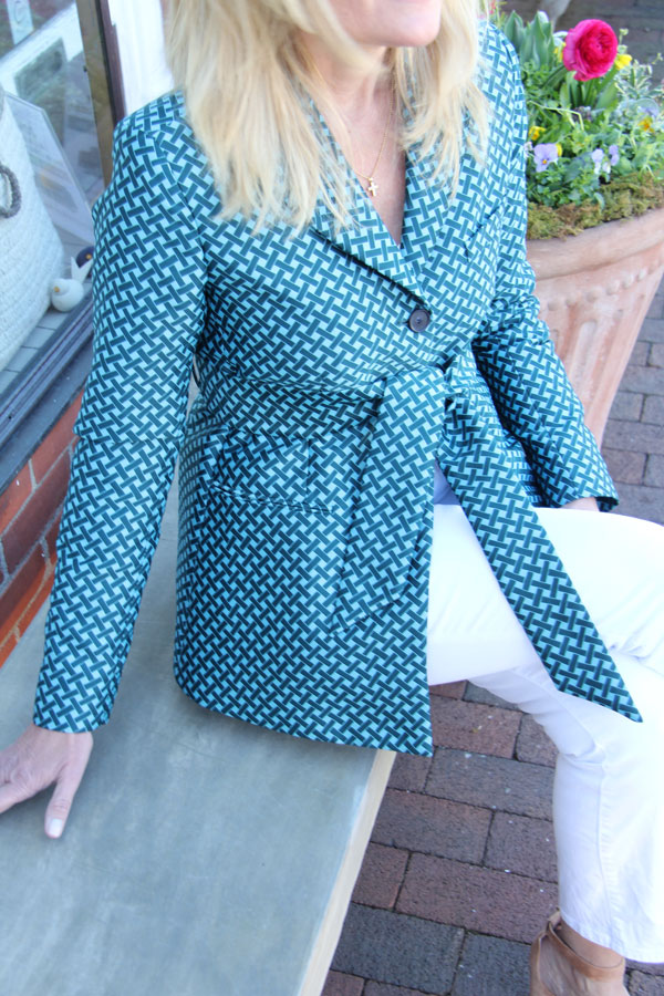 Ridgely Brode wears a teal basket weave jacket, white jeans and new suede block heels on her blog Ridgely's Radar.
