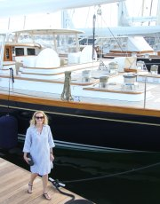Ridgely Brode wears her Striped Nautique Dress for a stroll along the boats in Newport, Rhode Island on her blog, Ridgely