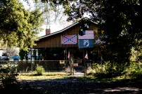 Plenty of confederate flags flying around in the rural south. Some scary signs up. They love their guns. Best keep moving. Near Silsbee, TX, USA