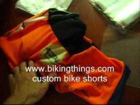 custom bike shorts, blue and orange custom cycling shorts