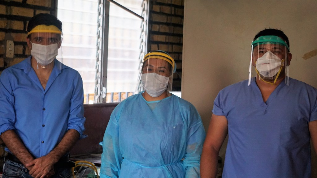 Delivery of masks to a local health center in Western Honduras. Left-to-right: Elvis, Mimi (nurse), Marvin (nurse).