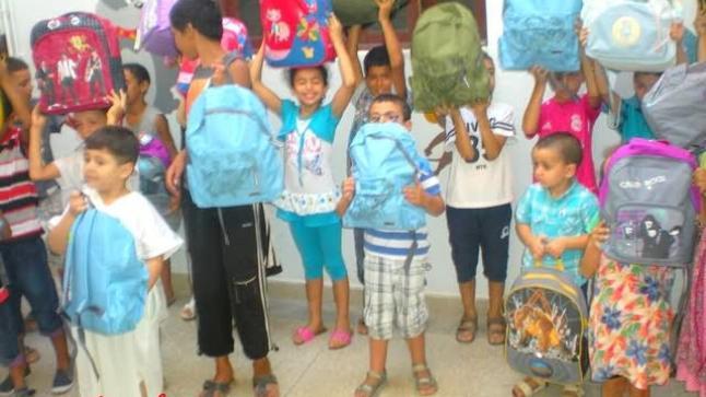توزيع المحافظ والادوات بجمعية المنظمة المغربية لإنصاف الأسرة بامزورن
