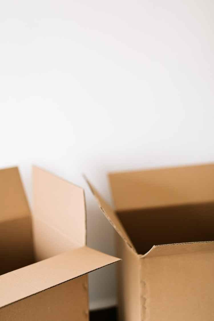 cardboard boxes against white plain wall