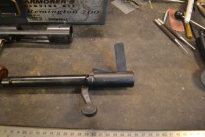 We use the bolt disassembly tool to grab and retract the firing pin