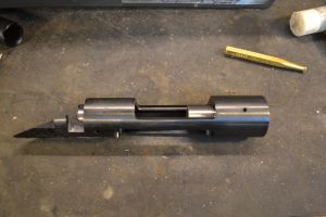 The kit includes two tapered bushings to guide the receiver reamer and tap.  We tap our bushings into place.