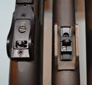 The Vang Comp rear sight (left) provides the shooter with an elevation adjustment screw.  On the Sage, the shooter unlocks the pinch screw on the side of the rear sight and slides the entire assembly to adjust elevation.