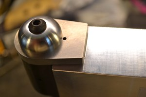 The bottom of the lug is aligned with the machined surface to ensure the lug is in the proper orientation prior to drilling.