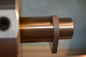 The insert tooling has a slight radius. Once the tenon is cut to diameter, the radius prevents the lug from firmly seating against the shoulder. Note the slight space in between the barrel shoulder and recoil lug shown here.