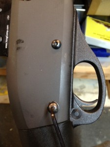The factory trigger plate pins are repalced by chicago style screws used to secure our Mesa side saddle shell carrier.