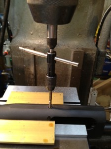 A spring loaded tap guide is placed in the milling machine chuck.  The 8-40 tap and handle are placed below the guide and the quill is lowered to tension the tap guide.  With Do Drill lubricating the tap, the tap is turned a half turn and then backed off to break the chip until the hole is threaded.
