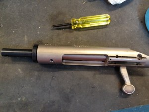 The tool bolt is inserted into its closed position and the spring loaded bolt lapping tool is screwed into the front of the receiver.