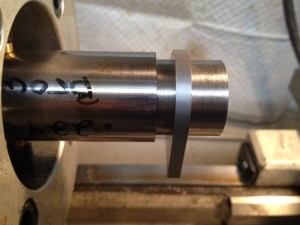 Using high speed steel insert cutters, the tenon shoulder is cut to accept the recoil lub provided with the action.