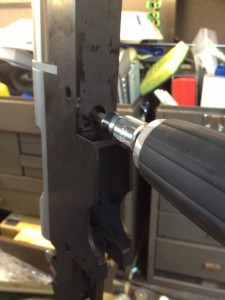 The barreled action is secured with two action screws.  We use a torque driver to ensure they are properly secured.