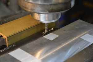 "A 3/16 solid carbide center cutting endmill is used to begin the bolt release mortise.  The endmill is inserted into the work at .193"" and stopped at .999"" from the rear vertical edge.  The depth of the mortise is .155"".   A through cut is then made from .729"" to .900""."