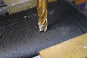 "With the stock secured on the milling machine in a vise, a 9/16"" center cutting end mill is used to drill a recess to house the flush cup."