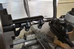 The bolt is secured in a LaBounty fixture in the lathe.