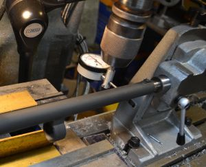 I aligned the barrel both vertically and horizontally in the mill using a dial indicator.  By indicating along the barrel I can make sure it is properly aligned.  Note: On this barrel, the diameter forward of the lug are the same diameter.