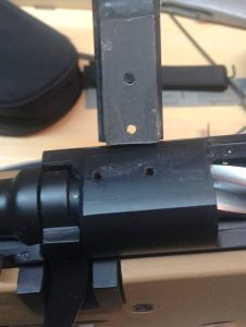 When the epoxy cures, I remove the front screws and inspect my work.  I use a drill bit to clean epoxy from the scope base holes.