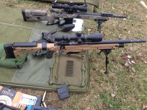 """The 16.5"""" 300 Winchester Magnum (front) has superior ballistic performance to the 16.5"""" 308 Winchester (back). This comes at the price of significantly increased muzzle blast, recoil, and cost of ammunition.  To realize the full benefits of the cartridge, take a look at a longer barrel."""