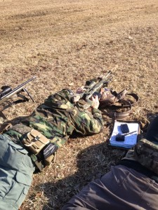 Sean Little, owner, Vapor Trail Tactical engaging a 500 yard target from SBU prone.  He is shooting an M40A5 with Surefire suppressor and S&B 3-12 day optic.