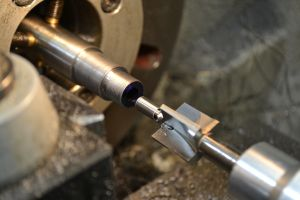 """A #3 piloted .420"""" target crown tool is secured in a reamer holder to crown the muzzle."""