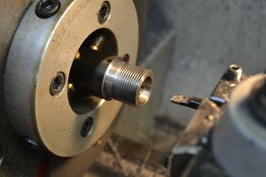 """A boring bar is used to cut the bolt nose recess.  Since this barrel has been previously chambered, a piloted .705"""" counter bore would not work since the pilot wouldn't have anything to guide it."""