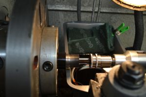 I cut the chamber using a floating reamer holder  and a reamer stop.  I am using my newly built chamber flush system to push pressurized oil through the bore.