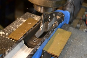 """With the action out of the stock.  I use a milling machine, with a sharp 1/4"""" end mill to clean up the surfaces."""