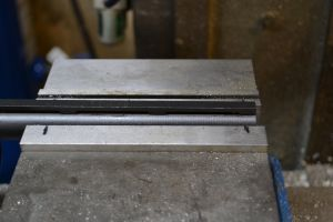 The barrel will be drilled and tapped for a 6-48 bead.  The barrel is set in the mill vise on a set of parallels.