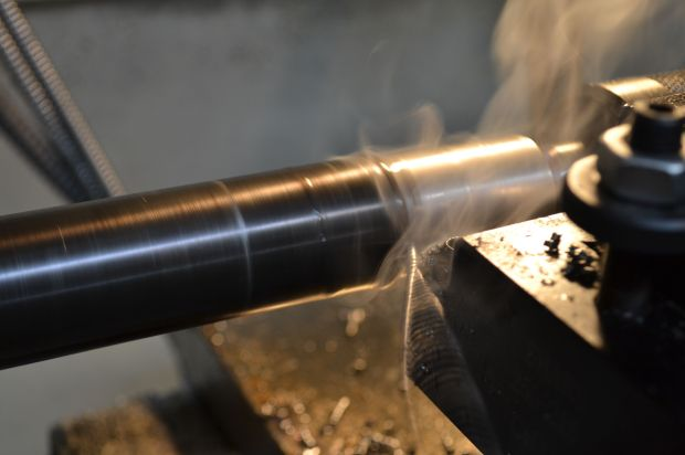 With the tailstock offset it is time to start cutting some metal.  I like using carbide tooling for heavy work like this.  The finish may not be as nice as a high-speed steel tool, but the carbide is far more durable for this application.