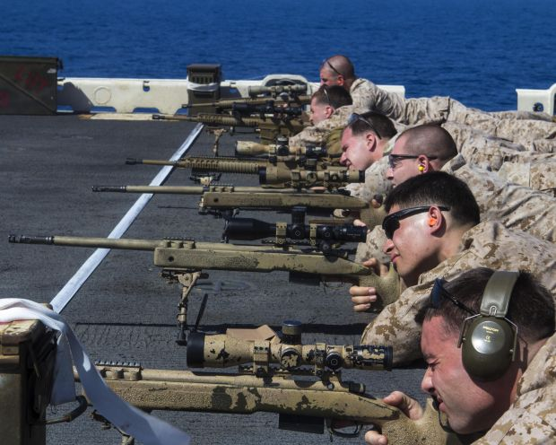 USS Kearsarge (LHD 3), At Sea, At Sea - U.S. Marines assigned to Scout Sniper Platoon, Weapons Company, Battalion Landing Team (BLT) 3/2, 26th Marine Expeditionary Unit (MEU), conduct a battlesight zero exercise on the flight deck of the USS Kearsarge (LHD 3), at sea, April 7, 2013. The 26th MEU is deployed to the 5th Fleet area of operations aboard the Kearsarge Amphibious Ready Group. The 26th MEU operates continuously across the globe, providing the president and unified combatant commanders with a forward-deployed, sea-based quick reaction force. The MEU is a Marine Air-Ground Task Force capable of conducting amphibious operations, crisis response and limited contingency operations. (U.S. Marine Corps photo by Lance Cpl. Juanenrique Owings/Released)
