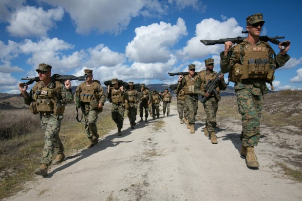 U.S. Marines with 11th Marine Expeditionary Unit (11th MEU) carry M240B machine guns and M249 light machine guns from a firing range after crew served weapons training at Camp Pendleton, Calif., Nov. 3, 2015. Crew served weapons training develops Marines efficiency with the M240B machine gun and M249 light machine gun and reinforces combat readiness. (U.S. Marine Corps photo by Cpl. Xzavior T. McNeal)