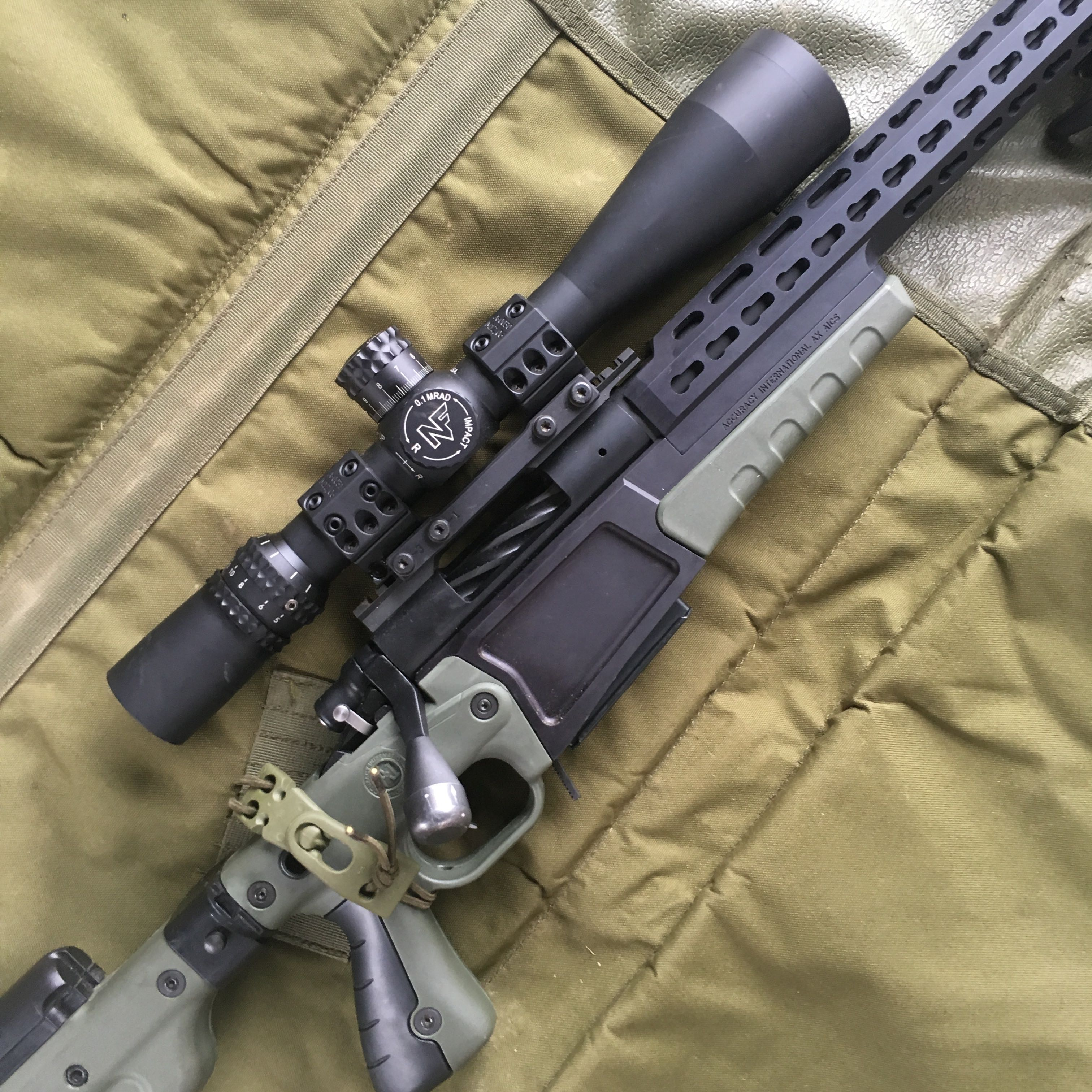 6x47-lapua-rem-700-aics-ax-nightforce-12
