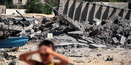 palestinian-child-inspects-damage-done-to-gaza-building-after-israeli-airstrike-bombing