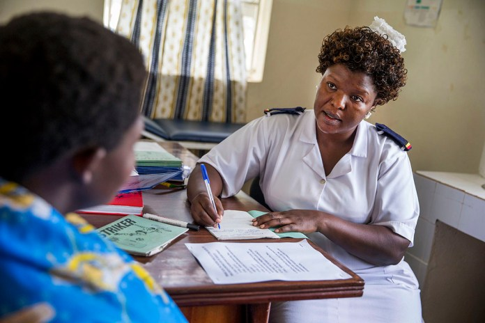 TORORO, UGANDA - JULY 25: Head antenatal nurse Margie Harriet Egessa providing antenatal counseling and checkups for a group of pregnant women at Mukujju clinic. This clinic is supported by DSW. July 25, 2014 in Tororo, Uganda. (Photo by Jonathan Torgovnik/Reportage by Getty Images)..