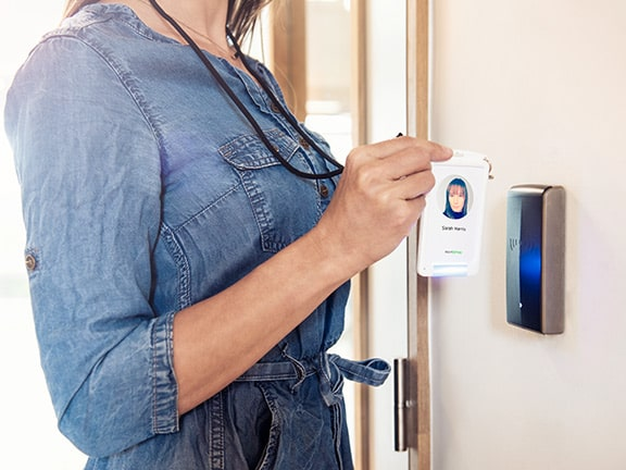 badgeholder against door card reader