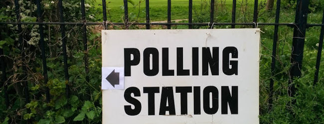 Polling station sign near Hampstead Heath, May 2015, by Bondegezou