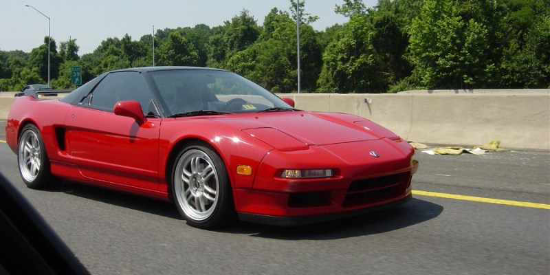 Rolling shot of Josh Taylor's red Acura NSX on the highway